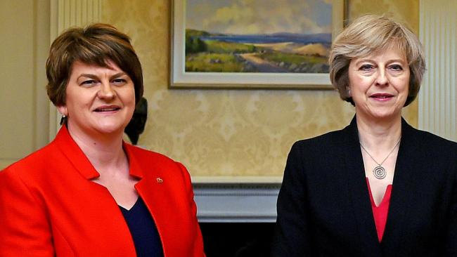 DUP leader returns to Northern Ireland, talks continue